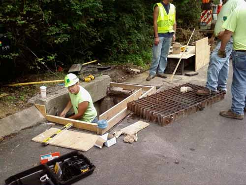 Cycle Trap Fixed :: Penn DOT workers repair dangerous drain grates